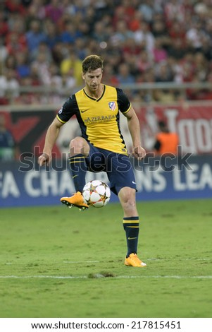 Piraeus,Greece Sept 16, 2014. Atletico's Cristian Ansaldi during the Champions League Group A soccer match against Olympiacos at Georgios Karaiskakis Stadium in the port of Piraeus near Athens.  - stock photo