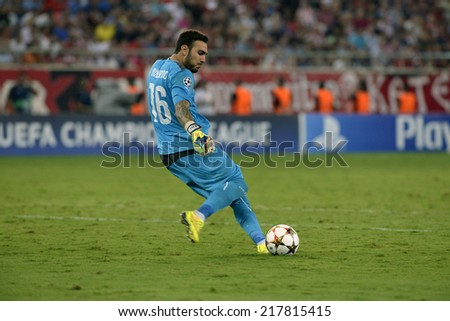 Piraeus,Greece Sept 16, 2014. Olympiacos goalkeeper Roberto during the Champions League  soccer match against Atletico Madrid at Georgios Karaiskakis Stadium in the port of Piraeus near Athens. - stock photo