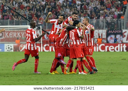 Piraeus,Greece Sept 16, 2014. Olympiacos players celebrate a goal during the Champions League soccer match between Olympiakos and Atletico Madrid at Georgios Karaiskakis Stadium in Piraeus near Athens - stock photo