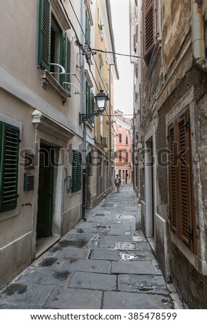 Piran old narrow street, Slovenia - stock photo