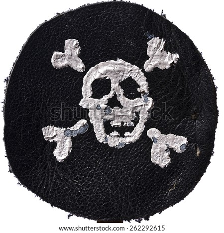 Pirate Black mark made of leather with skull and crossbones on white background - stock photo
