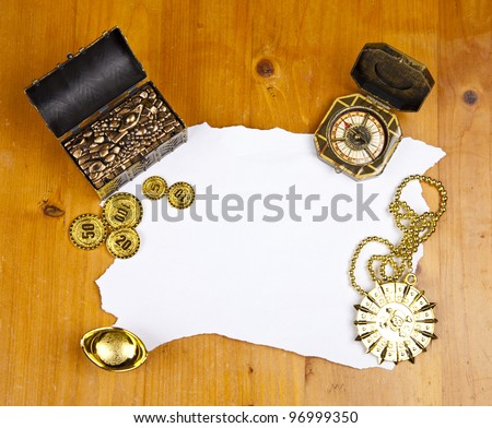 Pirate blank map with treasure, coins, medal and ring - stock photo