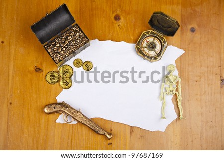 Pirate blank map with treasure, coins, skeleton and compass - stock photo