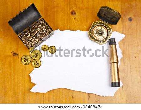 Pirate blank map with treasure, compass and binocular - stock photo