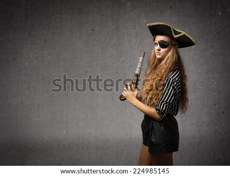 pirate blowing on an old gun - stock photo