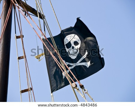 Pirate flag on the sailboat waving in the wind