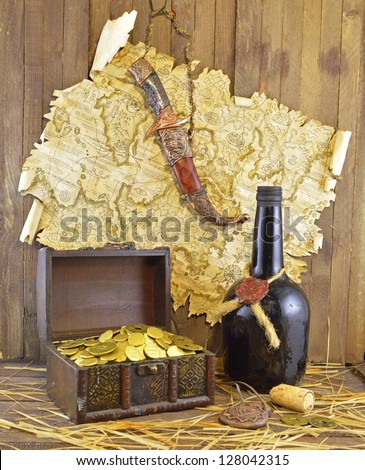 Pirate map with knife and bottle - stock photo