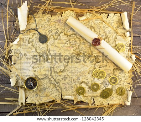 Pirate map with medallion and coins - stock photo