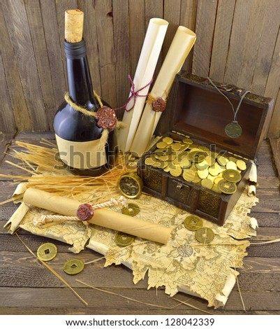 Pirate map with scrolls and bottle - stock photo
