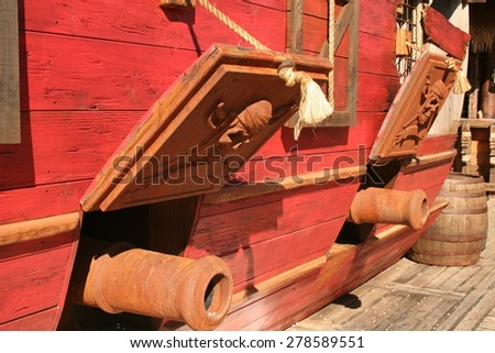 Pirate Ship. Cannons of a pirate ship. - stock photo