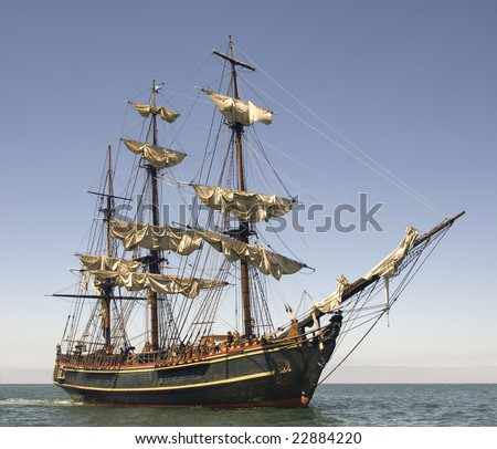 Pirate style ship setting sail on the high seas - stock photo