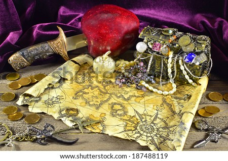 Pirate treasures with map and knife 2 - stock photo
