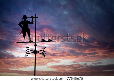 pirate weathercock against sunset - stock photo