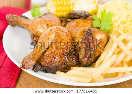 Piri Piri Chicken -  Spatchcocked poussin grilled with piri piri sauce served with fries, rice and corn on the cob. - stock photo