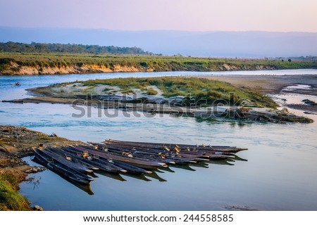 Pirogues on the Rapti river in Chitwan, Nepal - stock photo