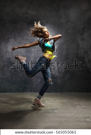 Pirouette, outside dance /Young energetic dancer performs modern dance pose  - stock photo