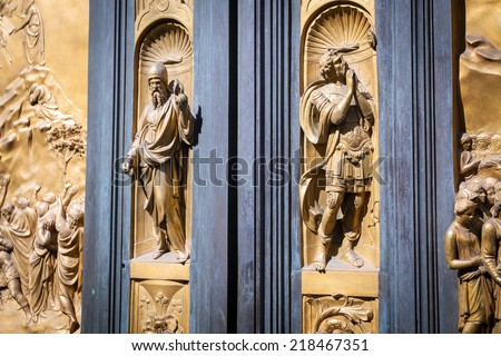 Pisa, Italy - August 11, 2013: Detail with soldier praying on the Gate of Paradise - Baptistery of San Giovanni, Florence Italy