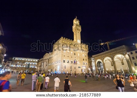 Pisa, Italy - August 11, 2013: The Palazzo Vecchio Romanesque Fortress Palace, the Town Hall of Florence, Italy - stock photo