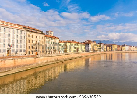 Pisa, Italy. Colorful palaces on the bank of river Arno in Tuscany.