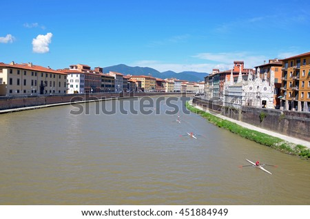 PISA, ITALY - JUNE 17 2016: Arno is a river in the Tuscany region and it flows through Pisa before reaching the sea.