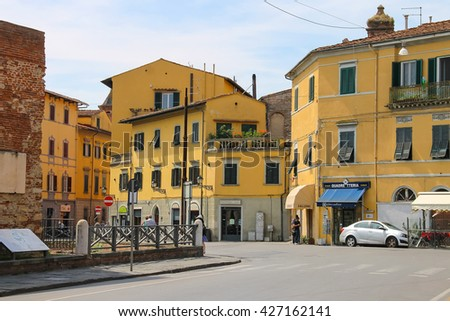 Pisa, Italy - June 29, 2015: People on the picturesque street of old town. Province Pisa, Tuscany region of Italy