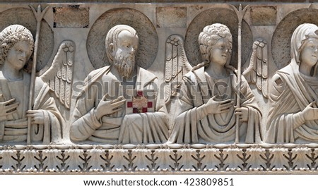 PISA, ITALY - JUNE 06, 2015: Saints and angels, Baptistery decoration architrave arches, Cathedral in Pisa, Italy. Unesco World Heritage Site, on June 06, 2015 - stock photo