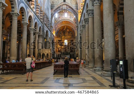 Pisa, Italy - June 29, 2015: Tourists inside of the Pisa Cathedral on Piazza del Duomo. Province Pisa, Tuscany region of Italy
