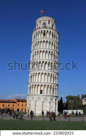 PISA, ITALY - MARCH 7, 2014: people in the famous Miracles square under the Leaning tower - stock photo