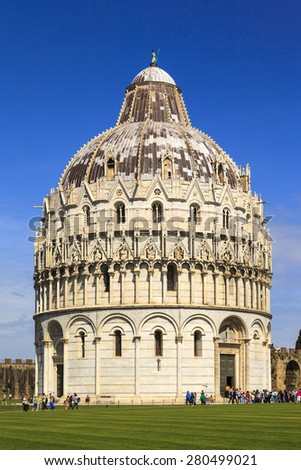 PISA ITALY - MAY 20 2014. Many statues and logo decorates the newly renovated Dome Primaziale Pisana in front of the leaning tower in Pisa, on May 20, 2014. Square of Miracles is UNESCO heritage.  - stock photo