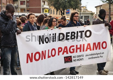 PISA, ITALY - NOVEMBER 14: Protesters march during a demonstration against austerity organized in all Europe as an european general strike on november 14, 2012 in Pisa, Italy - stock photo