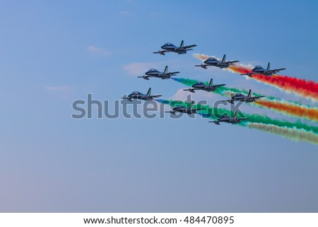 PISA, ITALY - SEPTEMBER 11, 2016: The perfect formation of Italian Frecce Tricolori during a exhibition.