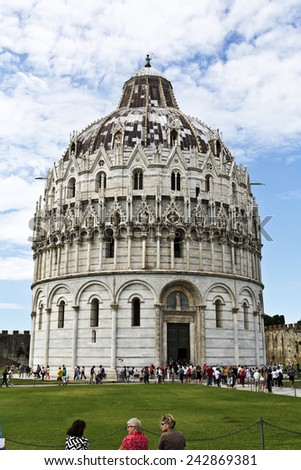 PISA, ITALY SEPTEMBER 3, 2014: Tourists visiting the Baptistry of St John, part of the Pisa Cathedral Complex - stock photo