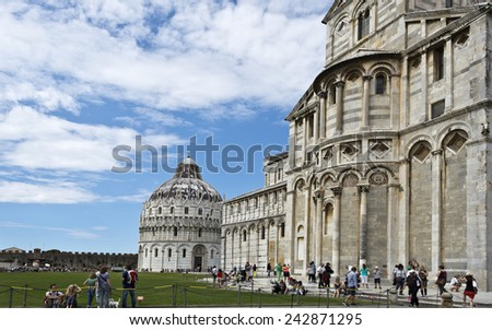 PISA, ITALY SEPTEMBER 3, 2014: Tourists visiting the Pisa Cathedral Complex - stock photo
