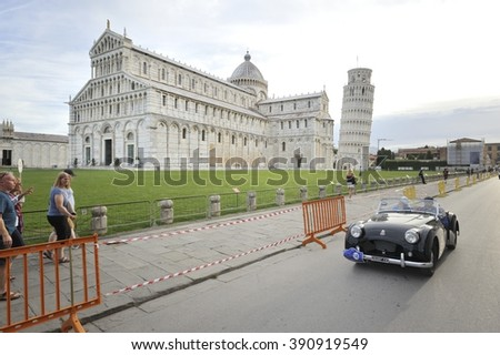 PISA (PI), ITALY - SEPTEMBER 19: A black Triumph TR2 takes part to the GP Nuvolari classic car race on September 19, 2015 in Pisa (PI). The car was built in 1954. - stock photo