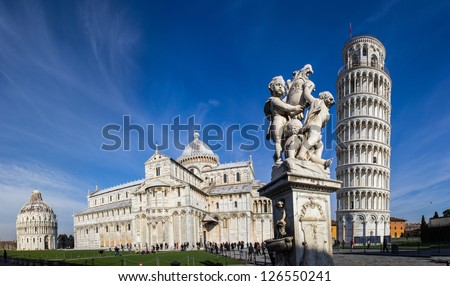 Pisa, place of miracles: the leaning tower and the cathedral baptistery - stock photo