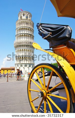 Pisa tower with horse carridge in front of - stock photo