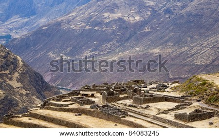 Pisac Peru; ancient Inca town showing buildings and agricultural terraces in Andes Mountains - stock photo