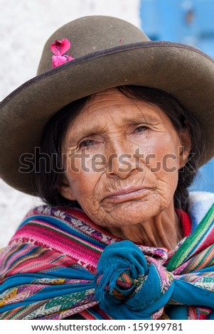 PISAC, PERU - JANUARY 3: Quechua woman with bowler style hat on January 3, 2010 in Pisac, Peru. The bowler hat was introduced by British railway workers in 1920. - stock photo