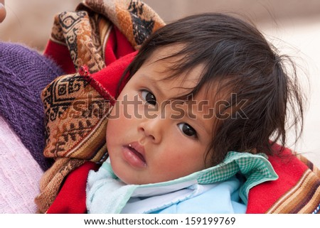 PISAC, PERU - JANUARY 3: Unidentified Quechua baby on January 3, 2010 in Pisac, Peru. The Quechua are a diverse indigenous ethnic group of the South American Andes. - stock photo