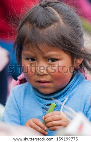PISAC, PERU - JANUARY 3: Unidentified Quechua toddler on January 3, 2010 in Pisac, Peru. The Quechua are a diverse indigenous ethnic group of the South American Andes. - stock photo
