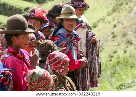 PISAC, PERU - MARCH 5, 2006: Unidentified people at Inca citadel in Sacred Valley near Pisac in Peru.Sacred Valley of the Incas is a valley in the Southern Sierra that contains many famous Inca ruins.