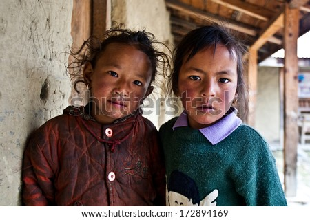 PISANG, NEPAL - NOVEMBER 4: Unidentified Tibetan girls in a local school on the famous Annapurna trail on November 4, 2008, in Pisang village Nepal. The majority of the local population are Tibetans.