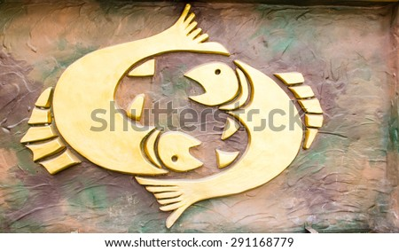 Pisces sign of horoscope on the wall - stock photo