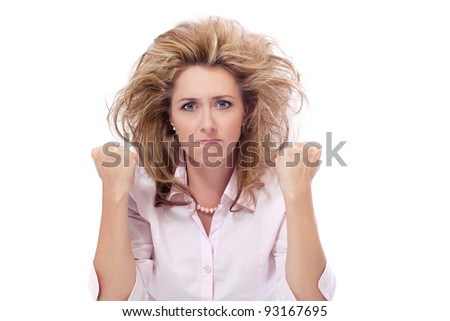 Pissed off / Beautiful angry caucasian mid adult woman holds her fists up ready to fight - stock photo
