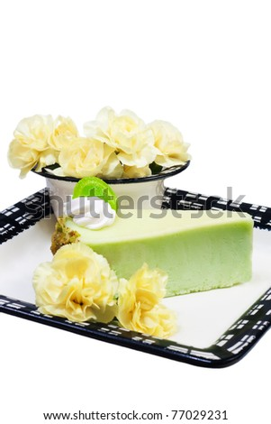 Pistachio cheesecake and flowers isolated - stock photo