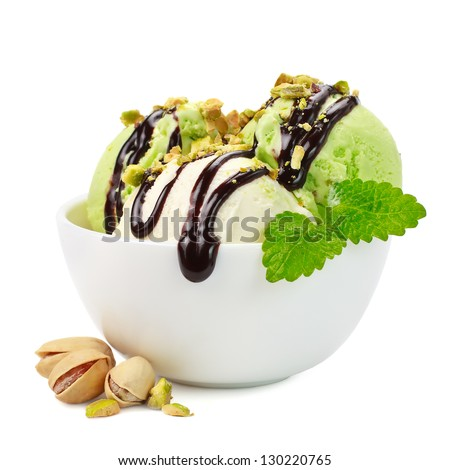Pistachio ice cream with mint on a white background - stock photo