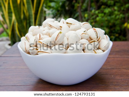 Pistachio in a bow - stock photo