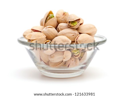 pistachio in a glass bowl isolated on white background - stock photo