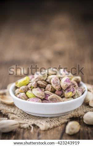 Pistachio Kernels as detailed close-up shot (selective focus) - stock photo
