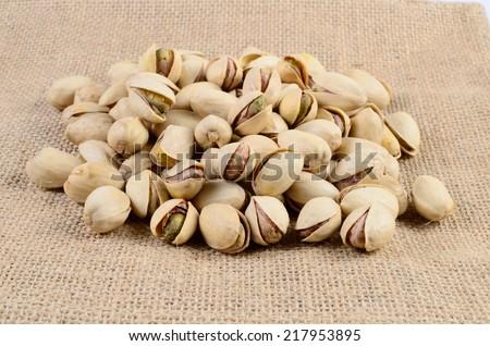 Pistachio nut on a sackcloth - stock photo